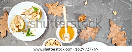 Banner of Tasty roast pears with honey and walnuts on grey background table. Stock photo © Illia