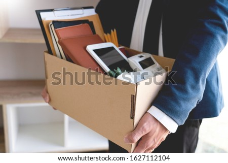 Sad Fired Young Employee businessmen hold boxes including pot pl Stock photo © snowing