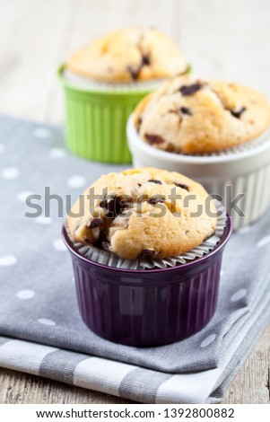 Three homemade fresh muffins on colorful ceramic bowls on linen  Stock photo © marylooo