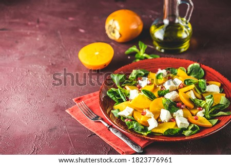Healthy salad with persimmon, doucette (lambs-lettuce, cornsalad Stock photo © artsvitlyna