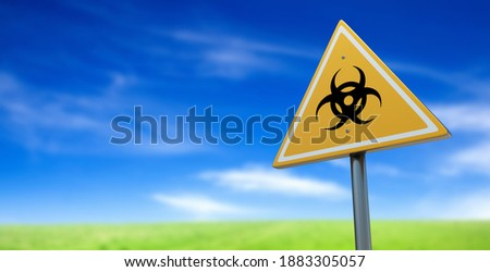 Bio-hazard Yellow Road Sign Against Ominous Stormy Cloudy Sky Stock photo © feverpitch