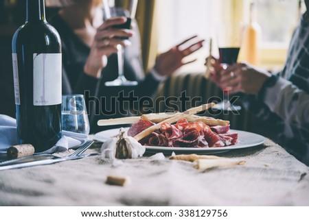 People in an Italian restaurant drinking wine and eating pasta Stock photo © Kzenon