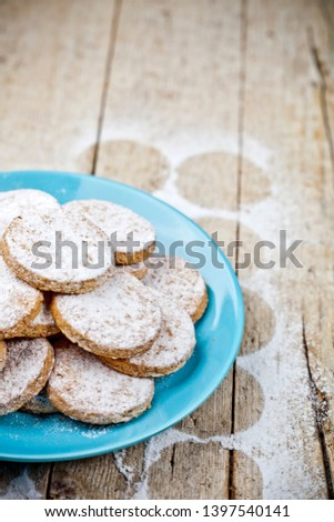 Fresh baked oat cookies with sugar powderon blue ceramic plate o Stock photo © marylooo