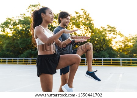 Photo of athletic caucasian sportsman doing exercise while working out Stock photo © deandrobot