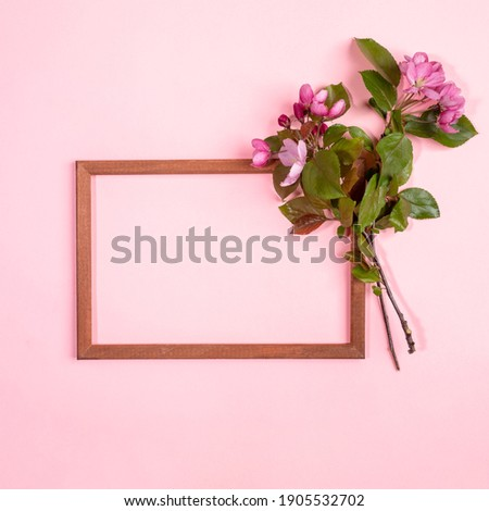 Greeting frame from fresh natural twigs of blooming cherry on a white. Stock photo © artjazz