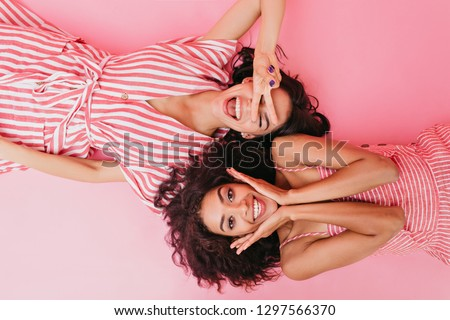 Image of two cheerful women posing at camera in stylish sunglass Stock photo © deandrobot