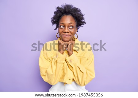 Pleasant looking brunette female fashion model keeps hand under chin, has full lips and applealing a Stock photo © vkstudio