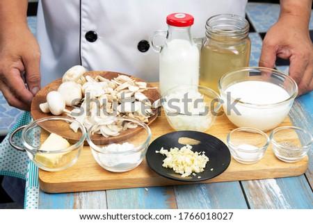 mushroom cream soup in bowl on cutting board Stock photo © dolgachov