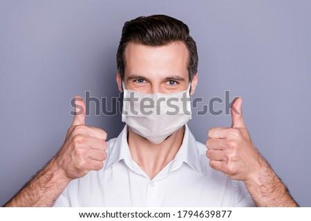 молодым человеком лице медицинской маске шоу Сток-фото © robuart