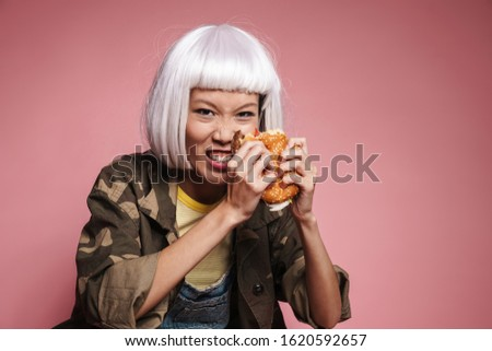 Image of asian girl wearing white wig screaming and eating big b Stock photo © deandrobot