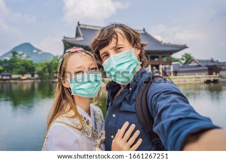 Young couple of spouses in medical mask. Bride and groom, a husband and wife, boyfriend and girlfrie Stock photo © galitskaya