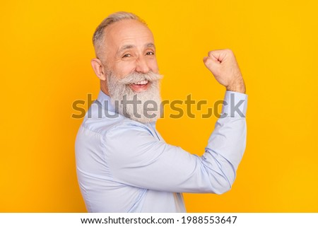 Mature Man Working Out Triceps On Grey Background Stock photo © Jasminko