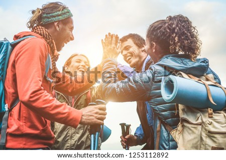 friends with backpacks stacking hands in forest Stock photo © dolgachov