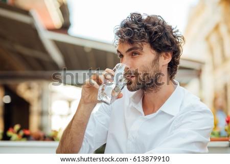 jóképű · üzletember · ivóvíz · iroda · lezser · ruha - stock fotó © hasloo
