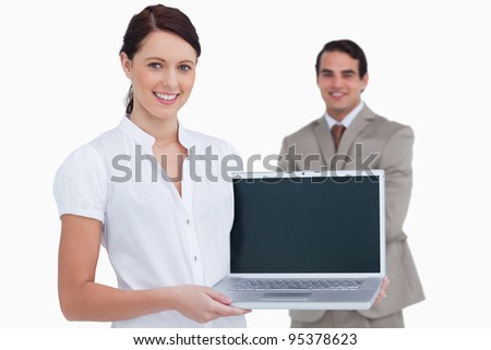 Smiling businesswoman showing her laptop against a white background stock photo © wavebreak_media