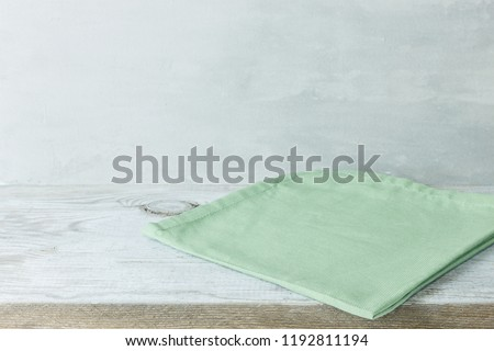 Empty gray ceramic dish on over blue and green background, squar Stock photo © CaptureLight