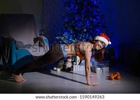 Erős mikulás súlyzó karácsony fitnessz erőteljes Stock fotó © MaryValery