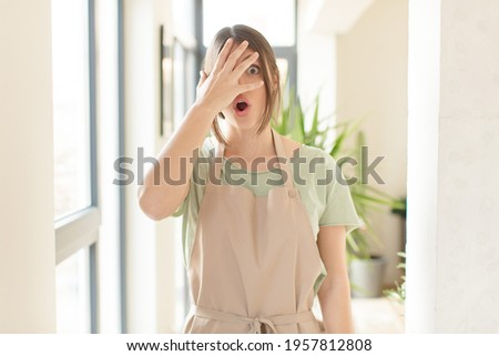 Portrait of excited or frightened woman preparing for injections Stock photo © deandrobot