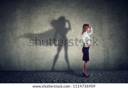 Businesswoman imagining to be a super hero looking aspired making career plans Stock photo © ichiosea