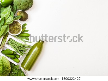 assorted green toned raw organic vegetables on white stone background avocado cabbage broccoli c stock photo © denismart