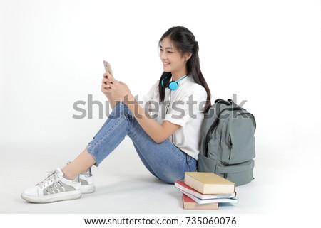 portré · mosolygó · nő · áll · mobiltelefon · mosolyog · fiatal - stock fotó © deandrobot