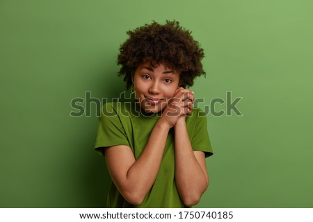 Photo of young african american woman smiling and keeping finger Stock photo © deandrobot