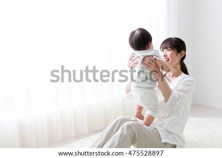 матери ребенка красивой комнату белый окна Сток-фото © Lopolo
