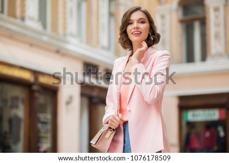 Beautiful smiling girl in stylish spring look walking at street. Stock photo © studiolucky