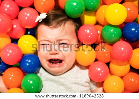 Portrait of a adorable infant on colorful balls dont have fun Stock photo © Lopolo