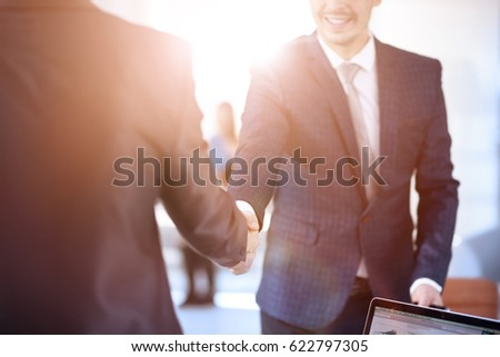 two business men shaking hands during a meeting to sign agreemen stock photo © freedomz