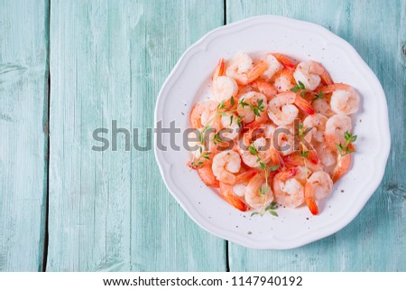 Boiled shrimps with lemons, greens and sauce on a wooden background. Stock photo © masay256
