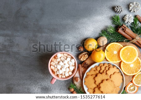 Hot drink with marshmallows, walnuts, mandarines and cookies on warm scarf Stock photo © pressmaster