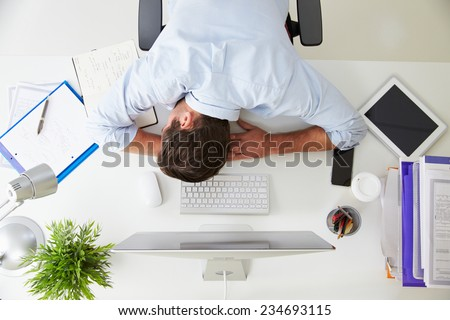 tired businessman sleeping at work in modern office with hand ho stock photo © freedomz
