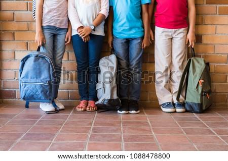 Low section of school kids standing in row in classroom of elementary school Stock photo © wavebreak_media