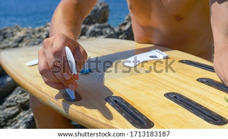 Close up wooden surfboard at beach on a sunny day Stock photo © wavebreak_media