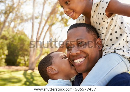 Side view of happy African American father and daughter relaxing on the sofa at home Stock photo © wavebreak_media