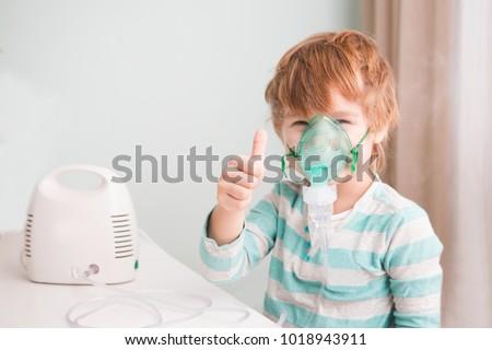 Malade garçon masque respiratoire Photo stock © ElenaBatkova