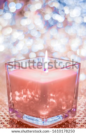 Coral aromatic candle on Christmas and New Years glitter backgro Stock photo © Anneleven