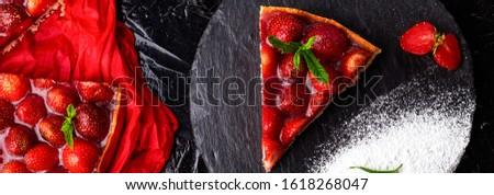 Banner of Homemade strawberries tarts on slate plate, black background. Stock photo © Illia