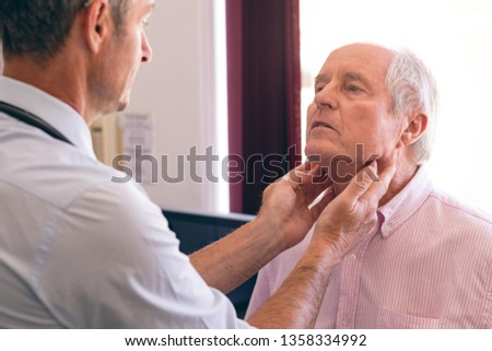 Rear view of a Caucasian confident male doctor interacting with female senior patient in clinic Stock photo © wavebreak_media