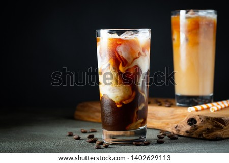 Glass of brew cold coffee and ice. Cold summer drink on a dark w Stock photo © artsvitlyna