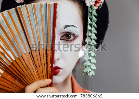 Image of young geisha woman in traditional kimono covering her e Stock photo © deandrobot