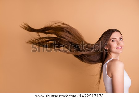 Beautiful female with long straight hair wears fashionable cape, stands over ancient city background Stock photo © vkstudio