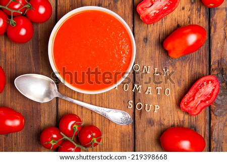 Black restaurant plate of creamy tomato soup and spoon on black table background with stone chopping Stock photo © DenisMArt
