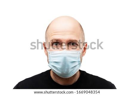 Young adult bald head man wearing respiratory protective medical mask Stock photo © ia_64