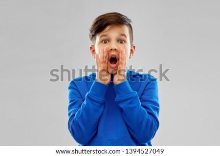 scared boy in blue hoodie shouting or calling Stock photo © dolgachov