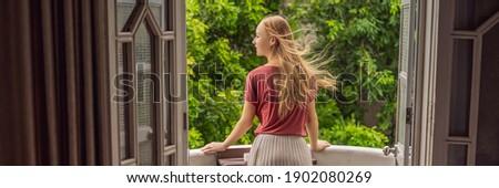BANNER, LONG FORMAT Young woman having a mediterranean breakfast, eats Healthy tropical breakfast, s Stock photo © galitskaya