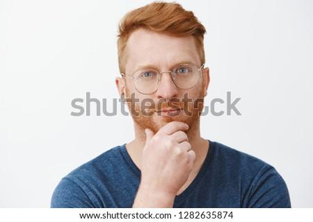 Handsome stylish male entrepreneur rubbing chin, smirk and look pleased camera, pondering interestin Stock photo © benzoix