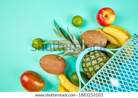 Grocery shopping bag with organic exotic fruits on blue background.  Stock photo © Illia