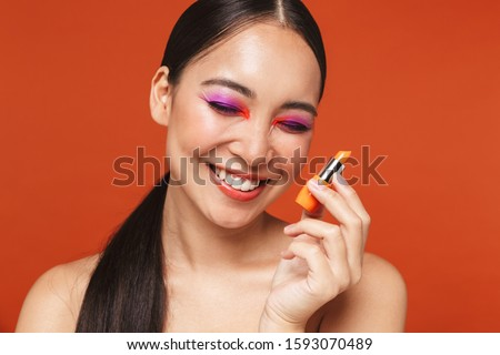 Beauty portrait of an attractive young topless asian woman Stock photo © deandrobot